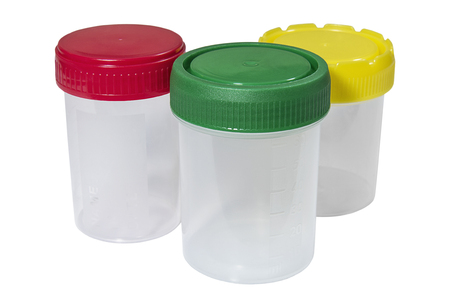 Medical plastic containers with multicolored caps on white background. Healthcare and medicine. Medical equipment.