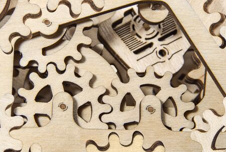 Wooden gearwheels close up. Mechanisms and devices.