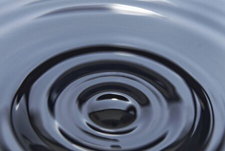 Round ripple on petroleum. Black backgrounds and textures. Banco de Imagens