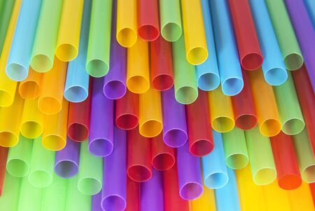 Colorful plastic cocktail tubes. Abstract background and textures. Food and drink conception.