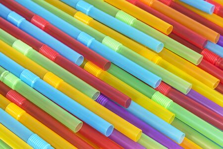 Colored plastic tubes for drinking. Abstract background and textures. Food and drink conception. Stok Fotoğraf