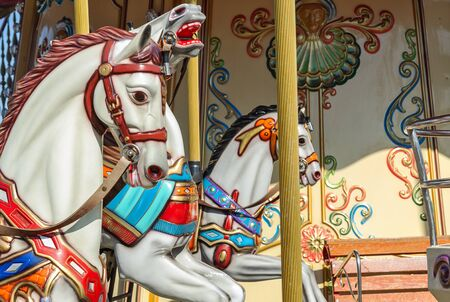 Fragment of childrens carousel close up. Attractions, games and entertainment.