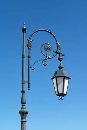 Street lamp of retro style against the blue sky. Vintage and retro.