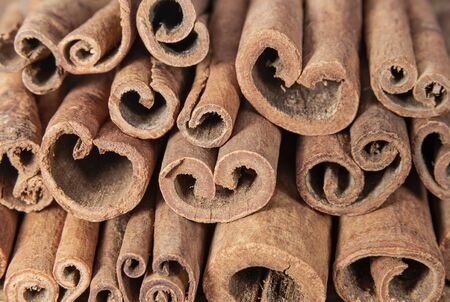 Aromatic bark of cinnamon background. Spices and seasonings Stok Fotoğraf