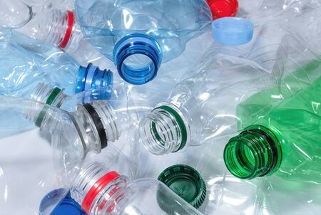 Crumpled plastic bottles close up. Recycling and reuse plastic waste concept