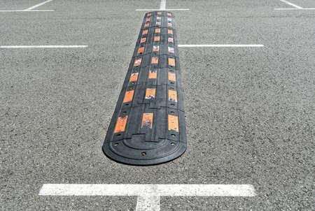 Speed hump on an asphalt. Traffic management and car driving Banco de Imagens