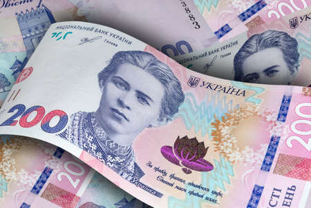 New banknotes of two hundred Ukrainian hryvnias. Business and finance