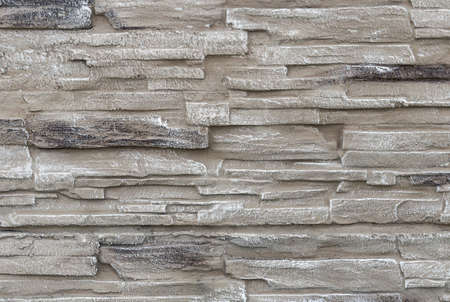 Concrete surface stylized as a flat stone masonry. Backgrounds and textures