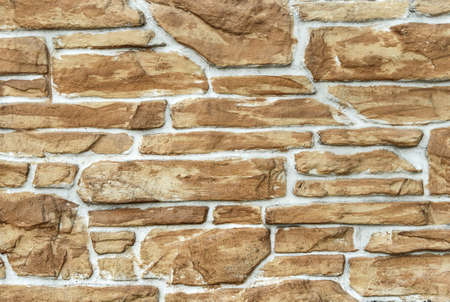Light brown stone masonry background. Art decor background. Backgrounds and textures 免版税图像