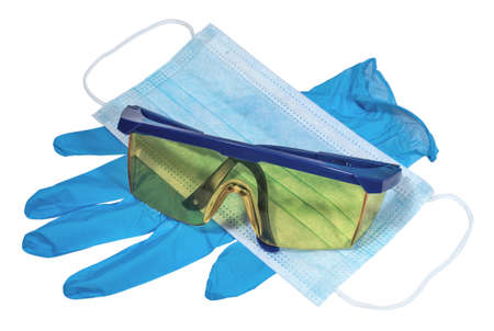 The blue face mask, latex glove, and protective eyeglasses on a white background. Medicine and personal protective equipment