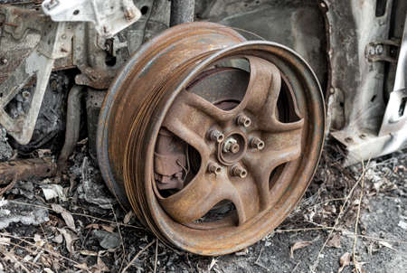 Rusty wheel assembly with brake caliper. Automotive and car repair Stock fotó