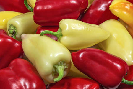 Yellow and red sweet peppers. Food and cooking 免版税图像