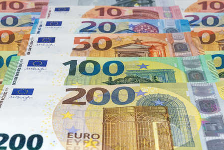 Euro banknotes of different denominations arranged in a row. Money, business and finances 免版税图像