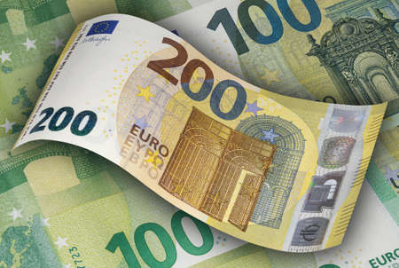 Two hundred EURO banknote on the background of hundred EURO bills. Money, business and finances
