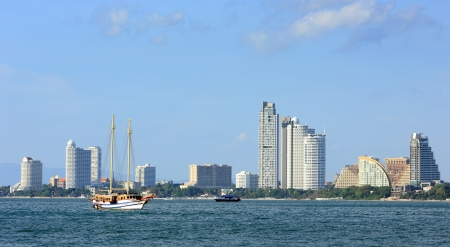 The view from the sea of the buildings and skyscrapers in Pattaya Beach photo