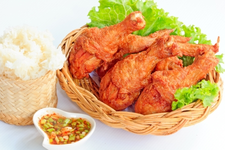 Hot Meat Dishes - Fried Chicken with Red Spicy Sauce and Sticky rice photo