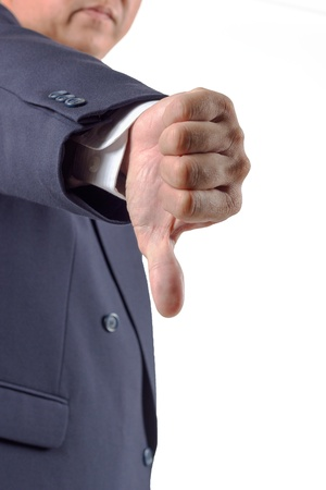 Hand thumb down by businessman  Rejection symbol photo