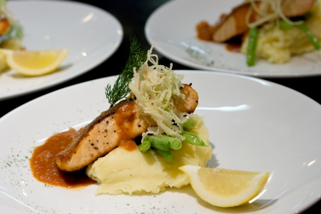 roquette: salmon steak with leomonade in the kitchen table