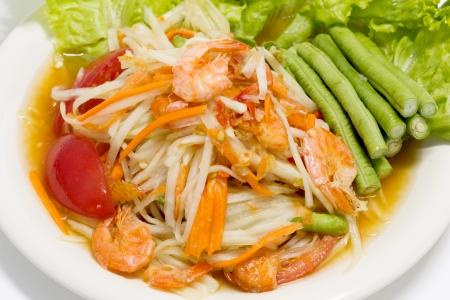 Thai cuisine - hot and spicy papaya salad photo