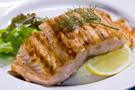 Salmon steak grilled with lemon photo