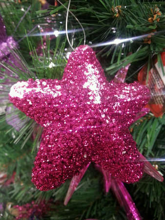 silver: Pink glitter Christmas ornaments hanging on purple n silver christmas ornaments tree