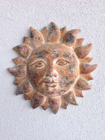Clay sun wall decor