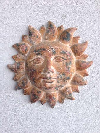 wall decor: Clay sun wall decor