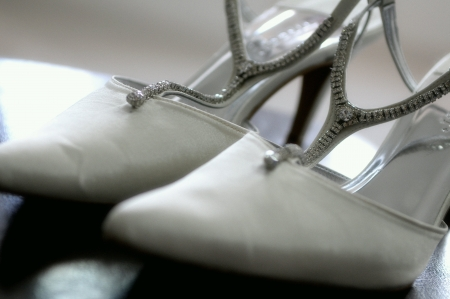 shiny: Close up of a white wedding heels