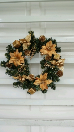 Christmas wreath hanging on grill door Stock Photo