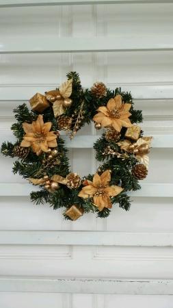 Christmas wreath hanging on grill door Stock Photo