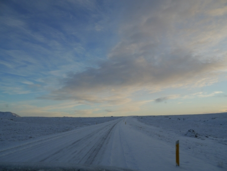 Driving Path filled with snow with blue sky
