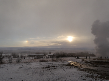 Geyser during winter with sunset Stock Photo