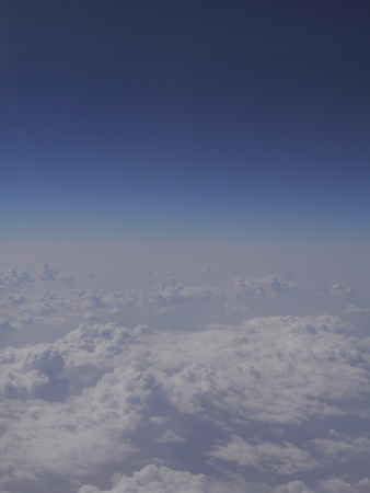 fluffy white clouds in blue sky Stock Photo