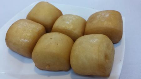 Plate of golden brown crispy bun mantao Stock Photo