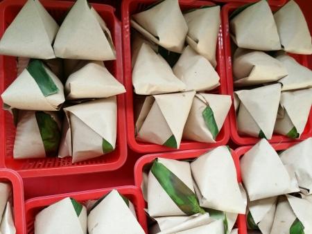 lemak: Nasi lemak packed in banana leaf Stock Photo