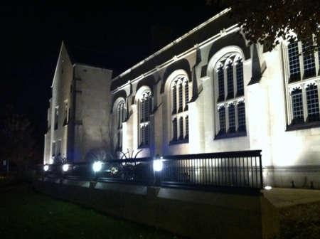 Limestone building at night