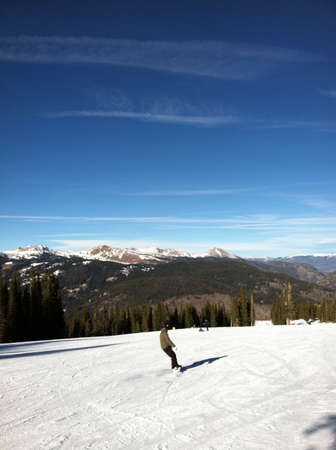 Skiing down mountain
