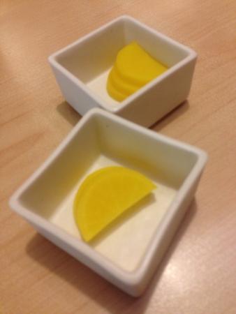 Japanese yellow radish served on white square bowl
