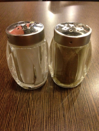 Salt and pepper shaker on wooden table