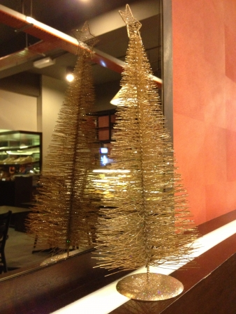 Golden mini Christmas tree in a cafe