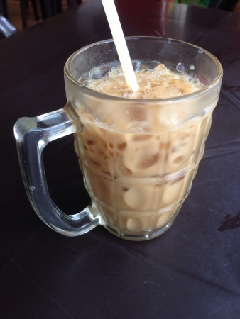 Ice coffee served in glass cup with straw Stock Photo