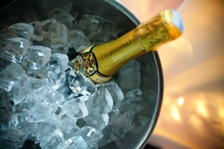Bottle of champagne in an ice bucket  Editorial