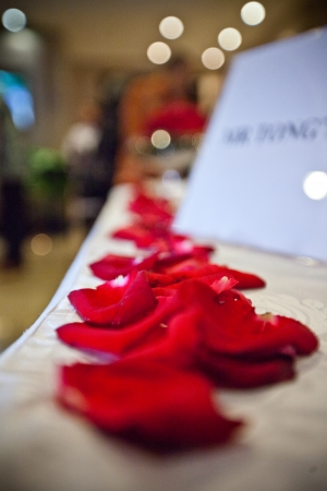 Close up shot of Flower petals arranged at reception table