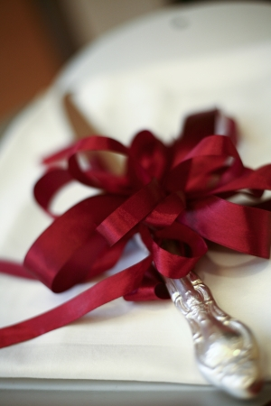 Close up shot of silver vintage cake knife with beautiful ribbons