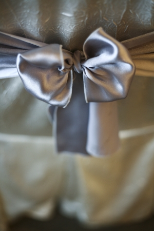 Close up shot of Silver bow tied to a banquet chair