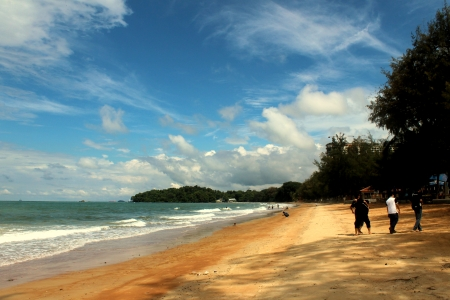 Beautiful landscape of the beach with clear blue sky and golden sand in Port Dickson