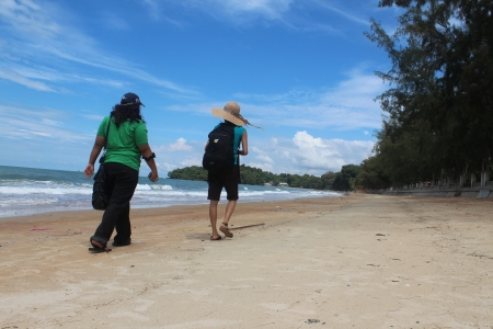 Friends walking along the beach Port Dickson