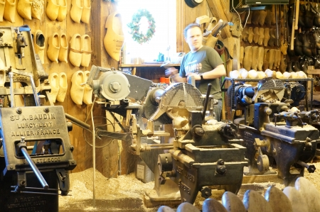 Zaanse Schans; Amsterdam - Holland Wooden Shoe Factory; man demonstrating on how clog was made