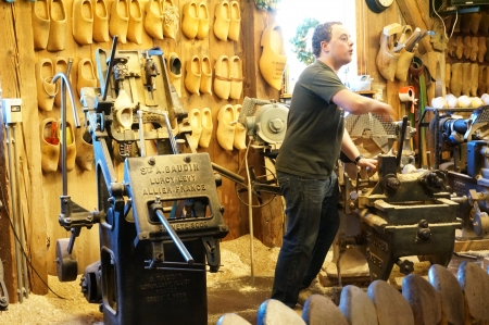 Zaanse Schans; Amsterdam - Holland Wooden Shoe Factory; man demonstrating on how clog was made