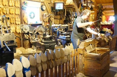 Zaanse Schans; Amsterdam- Holland Wooden Shoe Factory; man demonstrating on how clog was made Editorial